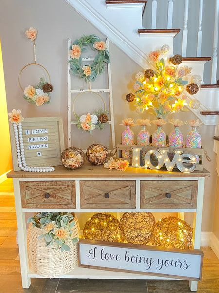 """""""I love being yours"""" - a Twinkle Lights and Cornbread original Valentine's Day design 💕  Romance is in the air 💕 the perfect farmhouse Valentine's Day entryway filled with soft peaches, whites and greenery. White washed woods, a tabletop twinkling tree, sparkling grapevine spheres, rustic glass bottles filled with sugary sweet conversation hearts, halo wreaths and rustic cursive signs combine to make the most whimsical space to ask your valentine to be yours 🤍   http://liketk.it/36IXG #liketkit @liketoknow.it"""