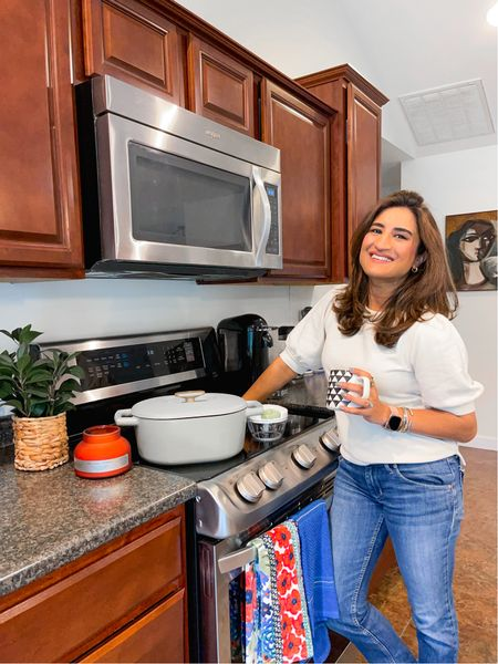 Welcome to my kitchen, where the struggle to ward off all the cooking smells is real. #ad This candle here is one of my favorite home finds. It smells so amazing, and makes the perfect gift. And speaking of favorite home finds, meet my new dutch oven from the drew Barrymore line @walmart. They come in a variety of colors and are perfect for soup season <3  Walmart truly is my one stop shop for affordable finds. Swipe to see My porch lanterns, jars for my laundry supplies, living room book shelves, and my ride or die kitchen appliance , the hand chopper.  Linking it all for you guys in stories.  #LTKSeasonal #LTKGiftGuide #LTKhome