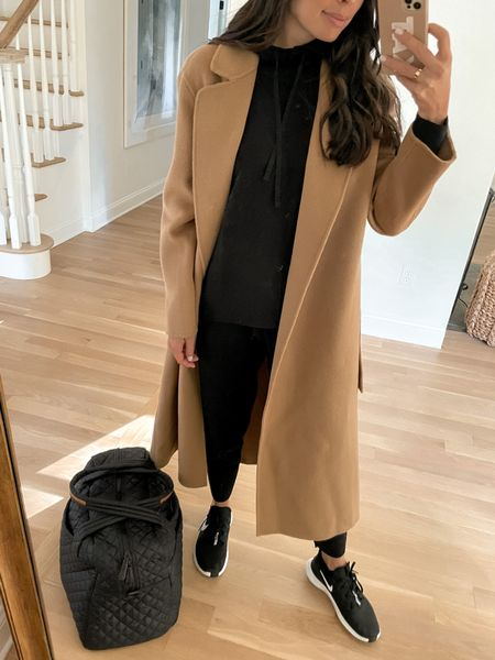 Travel style wearing a camel coat, matching jogger set and Nike sneakers. #camelcoat #travelstyle #sneakers  #LTKstyletip #LTKtravel