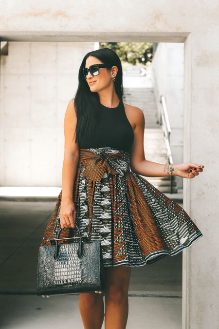 This skirt is from Sika and not linkable! I linked my black bodysuit that is currently on sale with code LTKAF2021 along with everything SITEWIDE. This snake embossed bag comes in this size and a mini. I linked both below!   #LTKsalealert #LTKstyletip #LTKSale