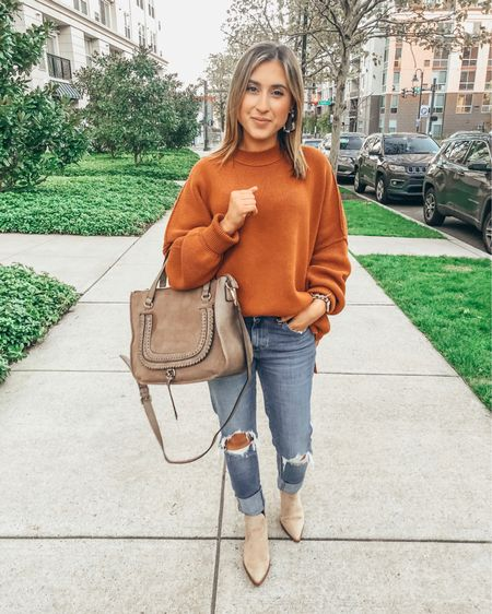 Happy Saturday! Alex and I are headed to the movies tonight and I plan to eat allllll the popcorn 🤗 what's everyone up to this weekend?! Also, yes, I bought this cozy oversized sweater in this rusty pumpkin color because I love it THAT much! Of course wearing it with my favorite suede booties, bomber jacket and ripped jeans! Also, trying out these cute little tortoise shell earrings for the first time and I'm here for them 💁🏻♀️  Shop all my looks on shoppedtilshedropped.com or in the LIKEtoKNOW.it app - simply download the app, give me a follow or screenshot one of my IG pics to shop! http://liketk.it/2Gspx #liketkit @liketoknow.it