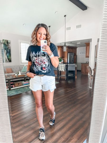 This graphic tee is on sale for $8. These shorts are on sale for $29. I am in a medium in the tea and a small in the shorts.  Graphic tee Sale White shorts Summer outfits.   #LTKsalealert #LTKstyletip #LTKunder50