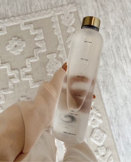 refill water bottle clear  water bottle - thick plastic (looks like glass) with times to track your water intake. Comes with gold cap in pack too. Found it on Amazon, amazon finds, health, healthy living, self care, neutral home, makes a great Christmas gift or any gift!   #LTKfit #LTKunder50 #LTKGiftGuide