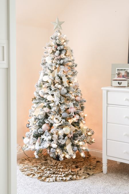 Last year I put up this jnexpensive flocked Christmas tree in my girls' bedroom and decked it out with this blush ornament collection. It was so easy, simple and budget friendly. And my girls LOVED it!! I had the lights on a timer so that every night when they went up to their room to get ready, the glow of the tree was there to greet them. Magical. I'll be reverting the whole this year and can't wait! . The tree is such a steal and sells out early each year. And I just saw that a very similar ornament set was back in stock, too! Target has so many cute ornament themed sets that would be so cute in a kids room or playroom. Be sure to tag me in your photo if you decorate one and share it!! .   #LTKHoliday #LTKSeasonal #LTKhome