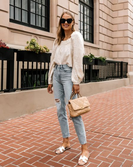 Love this linen top for summer! Lightweight and so comfy (tts). These are my new favorite ripped jeans too! (Size up) #summerfashion #linentop #madewelljeans http://liketk.it/3hFAX #liketkit @liketoknow.it #LTKstyletip #LTKunder100 #LTKunder50