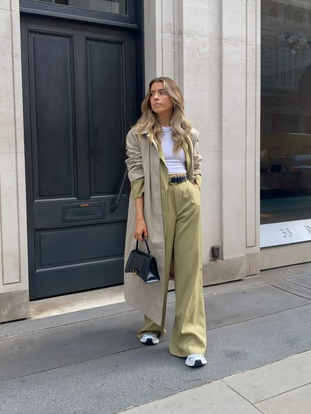 I love styling a trench coat over the top of a suit for a really relaxed smart look! This green suit is the perfect piece to take you from summer to autumn   I've finished the look with a pair of axel arigarto trainers and a balenciaga bag     #LTKeurope #LTKSeasonal