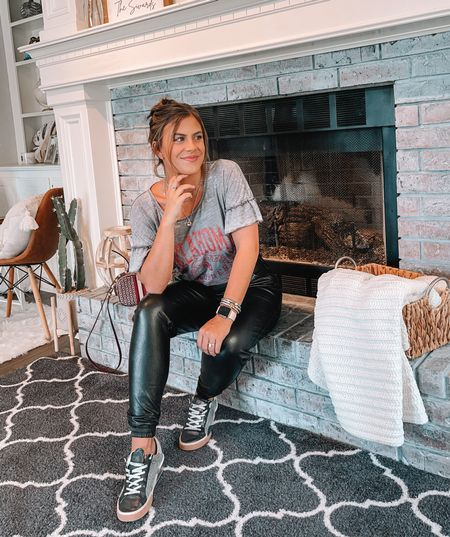 Casual Gameday outfit. Love these spanx faux leather joggers with a pair of sneakers and a fun top.   #LTKSeasonal #LTKunder100 #LTKunder50