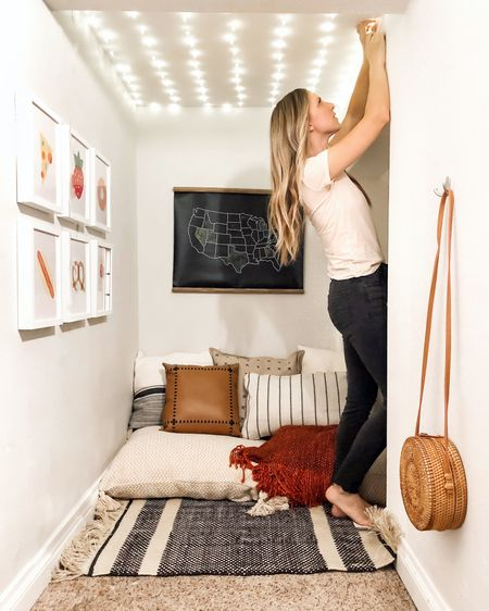 When in doubt, add fairy lights! Instant magic, even in a closet playroom🙌🏻. (See my stories for what I used). I am convinced that if I put twinkly lights in every room it would solve about 60% of my life stress. Right? Still deciding what to do with the cool new added space, but until then...I added some @walmart floor pillows, throw pillows and blankets for a makeshift couch. Coziest spot in the house! . #sponsored #WalmartHome #Startwithaspark http://liketk.it/2Fpff #liketkit @liketoknow.it