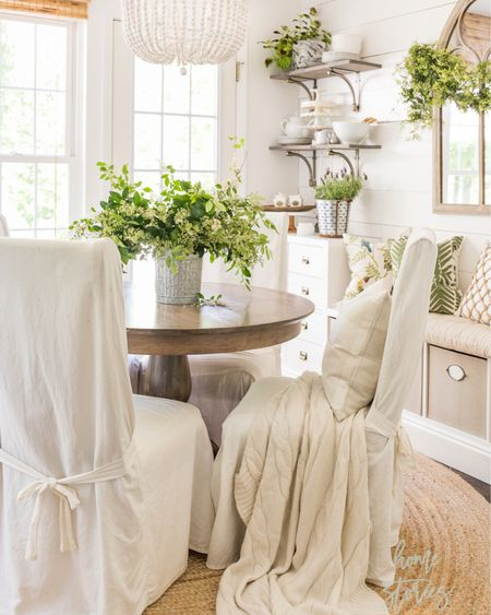 I love using clippings from the yard to create free arrangements! I clipped some branches from a tree on the side of our home and placed them in a galvanized ice bucket. It doesn't have to cost anything to be beautiful! Sources for my breakfast room can be found on @liketoknow.it and under Shop My Rooms on the blog. http://liketk.it/3eETE #liketkit  . .  #LTKunder50 #LTKhome #diningroom #diningroomfurniture #frenchcountrystyle #cozyhome #chairslipcovers