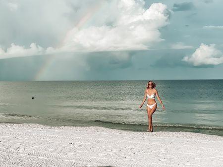 Rainbow on the beach! Bikini tropical vacation packing list  Swimsuit revolve   #LTKtravel #LTKswim