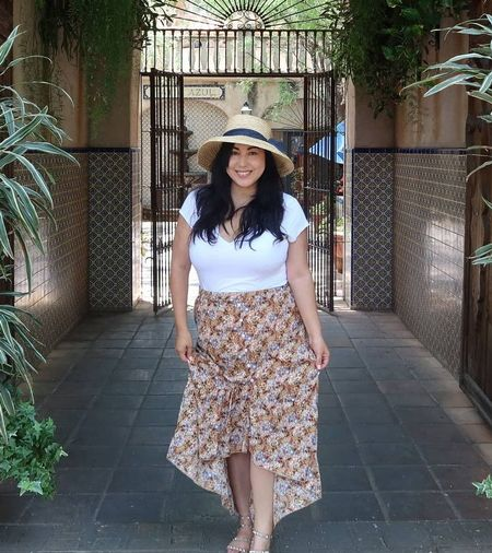 Here's a nice little travel outfit or heading into fall look idea for you. I've linked my exact top, skirt, sandals, and earrings. My hat is actually old from target so I linked similar options below.   #LTKcurves #LTKunder100 #LTKunder50