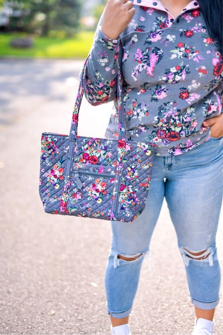 """5% of profits of Vera Bradley new print in Hope Blooms goes to breast cancer research! Use code """"queencarlene"""" for an additional 10% off   Sweatshirt (L), jeans are seven (31, TTS), & shoes are converse (size down 1.5 sizes)  Vera Bradley collection, travel essentials, #verabradley, travel must-haves, backpacks, floral bags, Vera Bradley travel, casual style, midsize, mid size, aerie, light denim jeans, converse, high rise denim, size 12, size 14, high tops, fall fashion, fleece, sherpa   #LTKitbag #LTKsalealert #LTKHoliday"""