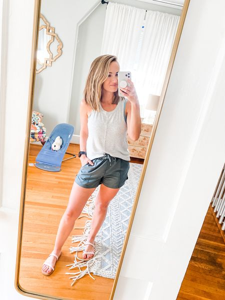This gray workout top has become one of my all time favorites because of the cute seam down the middle! I'm also loving these white sneakers— cute enough for a casual outfit but also made for fitness so great for walking with Thomas 🙌🏼 #athleisure #casualeveryday  #LTKfit #LTKstyletip #LTKfamily