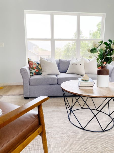 Wood and metal round coffee table with a gray couch in this living room set up.  Coffee table, modern farmhouse decor, round coffee table, living room decor, home decor, living room style  #LTKhome