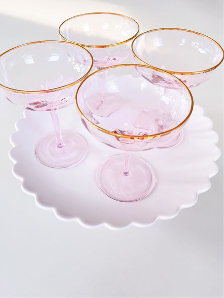 My pink and gold champagne coupes are back in stock and on sale! Also linked an ice bucket that coordinates. Makes a great wedding gift.   #LTKhome #LTKsalealert #LTKwedding