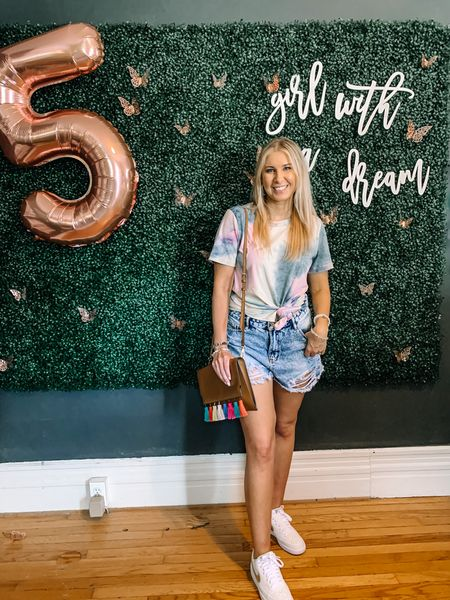 Who loves tie dye!? 🙋🏼♀️ I do! Its so bright and fun for summer ☀️ These tie dye tees are perfect for pairing with a great pair of denim cut offs and sneakers like I did here. @liketoknow.it #liketkit #LTKunder50 #LTKstyletip http://liketk.it/3gTp0