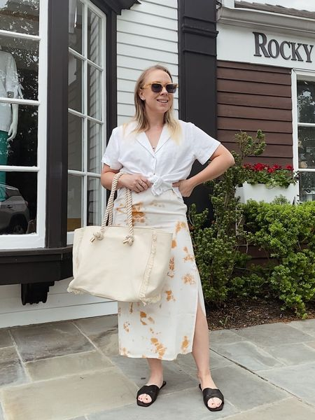 Casual dressy - paired an old closet staple skirt with a new linen top from Target - tote bag is HM and I love the gold details   Use code MELISSJ15 for 15% off at MVMT for her   #LTKsalealert #LTKstyletip #LTKSeasonal