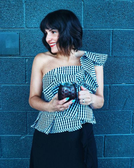 Tonight I got to try Crown Royal's new limited edition #TexasMesquite whiskey. It was so smoky and delicious! Check out my Instagram Story to see more from the tasting tonight at Stubb's, and get details on this fab ruffled gingham asymmetric top on @liketoknow.it here: http://liketk.it/2vRX1 #liketkit