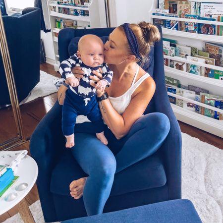 Navy blue and white nursery. Here's our AMAZING glider and reading nook. 📚   #diynursery #babyboynursery #tropicalnursery #nurserythemes #diyhome #diy #homedecoration #homedecorinspo #interiordesigninspiration #decorinspiration #decorinspo #homedecorblogger #momfluencer #momblog #nurseryinspo #potterybarnkids #jungletheme #junglethemenursery #tropicaltheme #tropicalthemednursery #babyboynursery #babyroom #babyroomideas #nurseryideas #nurserydecor #boynursery #navybluenursery   #LTKfamily #LTKhome #LTKbaby