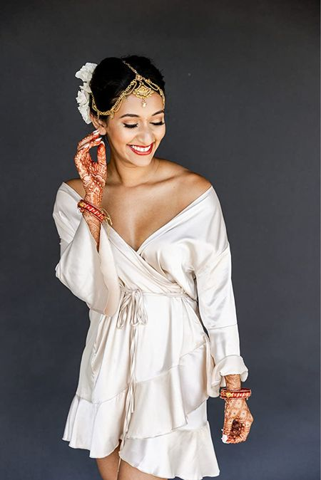 The most perfect robe for wedding day getting ready pictures! It's comfy, cute and so flattering! Wearing size x-small in the Hotouch Women's Satin Robe Pure Color Short Kimono Robes Ruffle Hem Oblique V-Neck Bridesmaid Wedding Party Bathrobe. Amazon fashion find!   #LTKwedding #LTKstyletip #LTKunder50