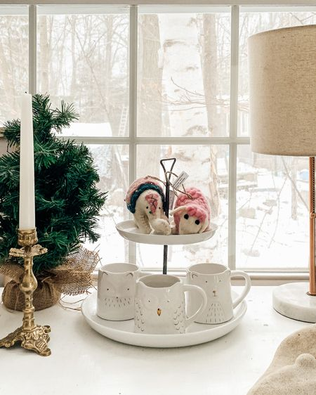 Our Christmas home decor on the side table, using cute little ornaments and white mugs on a two tier cake stand. 🌲🦌✨  #LTKhome #StayHomeWithLTK #LTKgiftspo