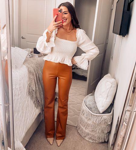 Fall ootd / fall style / leather pants / ruffle white top / nude heels   #LTKSeasonal #LTKunder50 #LTKunder100