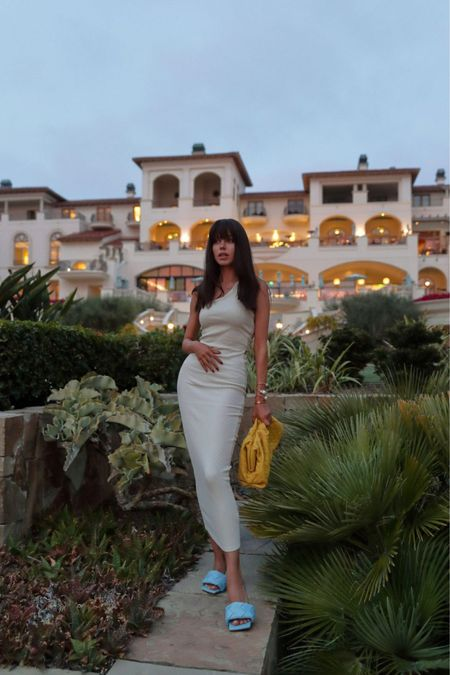 Summer vacation evening outfit - form fitting maxi dress - love the one shoulder and cut outs on the back - and chic accessories- Bottega Veneta woven leather clutch and sandals   #LTKshoecrush #LTKstyletip #LTKitbag