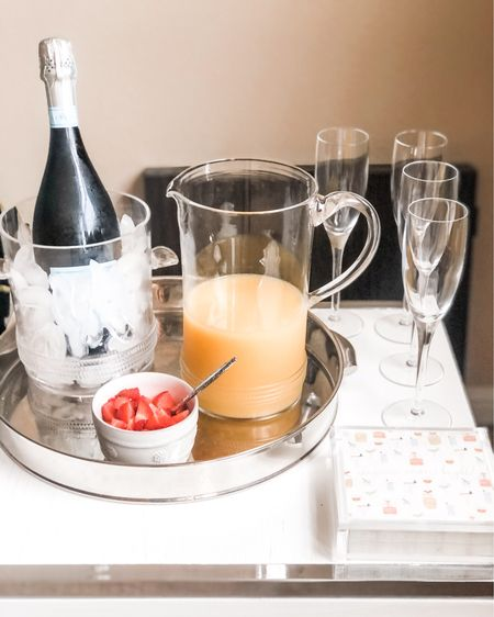 Cheers to this cute bubble bar! 🍾🥂 Load up a silver butler tray with a champagne bucket / ice bucket, glass pitcher, and berry bowls / ramekins, add champagne flutes and this acrylic cocktail napkin holder with some fun paper napkins. I linked some of my favorite summer cocktail napkin patterns from Amazon too! Bar accessories, bar ware  . . Bar cart, bar cart styling, bar style, Shop your screenshot of this pic with the LIKEtoKNOW.it shopping app http://liketk.it/3jg8l #liketkit @liketoknow.it #LTKhome #LTKunder100 #LTKunder50 @liketoknow.it.home