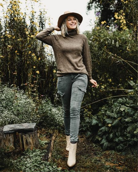 H&M turtleneck tunic sweater $30 Cargo pants  Wide brim floppy fedora hat Ankle booties   http://liketk.it/2H8TS @liketoknow.it #liketkit #LTKstyletip #LTKholidaystyle thanksgiving outfit, casual, fall style