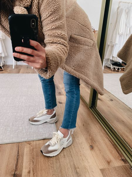 Tory Burch sneakers. Brown dad sneakers.   Sneakers - Tory Burch 5.5. These run small. Go up at least a full size.  Jeans - AG 24 (can't be linked)  Coat - Gap xs petite     #LTKshoecrush