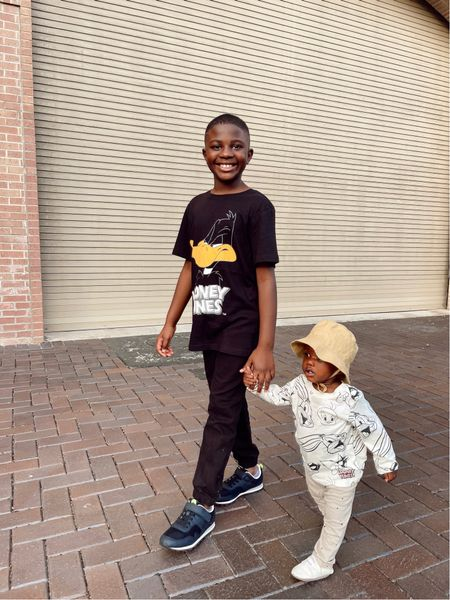 Looney tunes sibling outfit! Daffy Duck graphic tee with black joggers and black sneakers for big boy and long sleeve looney tunes print with polka dot pant for baby with a sun hat.   #LTKkids #LTKfamily #LTKunder50