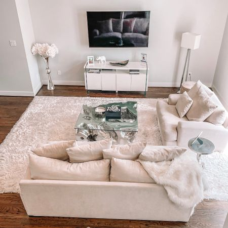 Neutral monochromatic modern glam living room. Living room decor. All white room. White sofas. White shag rug. Tom Ford book. Z gallerie. Silver accents. Modern white console credenza. Floor lamp. Tall vase. Fur throw.   #LTKstyletip #LTKhome