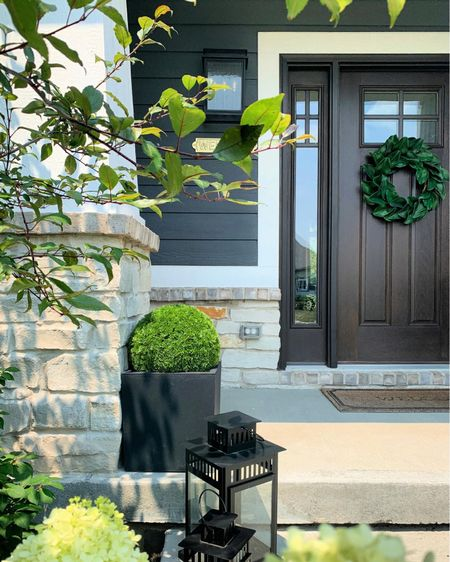 """If  you don't have a green thumb or don't like to water plants or don't want to spend money on flowers every season…these faux """"plants"""" for your containers are for you!  I found the perfect solution for our front porch and had to share. These faux greenery balls are the BOMB.   Click on this photo in my profile link to read all about them. 😍😍    #LTKhome http://liketk.it/3pecT #liketkit @liketoknow.it"""