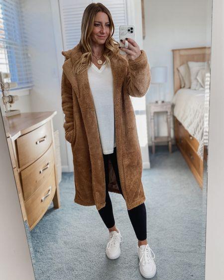 Faux fur teddy coat, white long sleeve, black leggings, white sneakers  http://liketk.it/310kM #liketkit @liketoknow.it #LTKunder50 #LTKsalealert