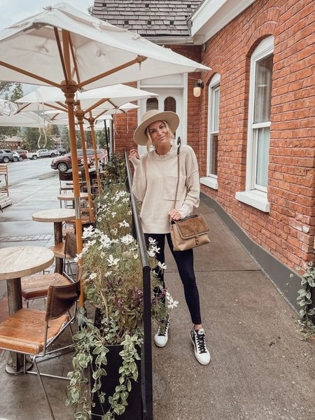 Love this cream sweater with spanx faux leather leggings and snake print sneakers 🖤  #LTKstyletip #LTKSeasonal #LTKshoecrush