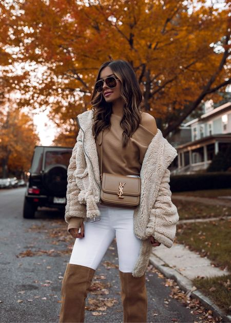 Fall outfit from Nordstrom  Free People camel off the shoulder top wearing an XS Madewell white denim wearing a 23 Treasure & Bond over-the-knee boots Saint Laurent Solferino bag   #LTKitbag #LTKSeasonal #LTKstyletip