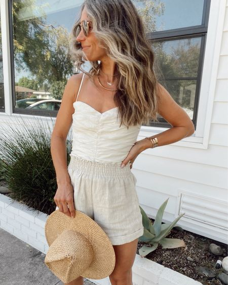 Corset linen top and linen shorts from August's capsule wardrobe… size up in shorts it you want them a little looser/longer, top is true to size with a back zipper and straps are removable if you want to wear it strapless //   #LTKstyletip