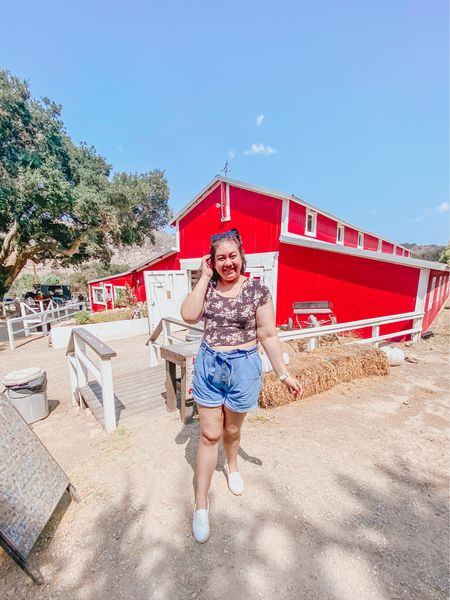 The Big Red Barn Life! 🚜❤️ Spent the day at a ranch a few weeks ago and took so many pictures! 📷 I last visited this place when I was 11 years old and it brought back so many memories. ✨ I had so much fun petting the horses and exploring the stables to visit all the farm animals. 🐎🐴 It felt like I was in the Hannah Montana movie but sadly unlike a Hallmark film I love watching I didn't fall in love with a misunderstood ranch hand or cowboy. 🎥🧑🏻🌾 Maybe next time? 🤠😂 For outfit details, I wrote a full blog post about what I'm wearing and to see more of this than I filmed a day in my life vlog over on my YouTube channel! Both are linked in my bio! 💻👉🏻 By the way, happy first day of fall y'all! 🍂 Have you ever visited a ranch like this? 🤔  #LTKcurves