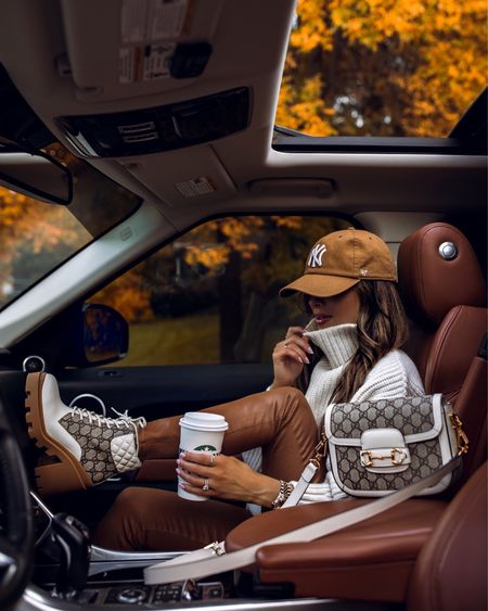 Fall casual outfit Anine Bing chunky knit white sweater wearing an XS L'Agence camel pants wearing a 23 Gucci combat boots  Gucci Horsebit white mini bag NY Yankees cap  #LTKstyletip #LTKitbag #LTKshoecrush