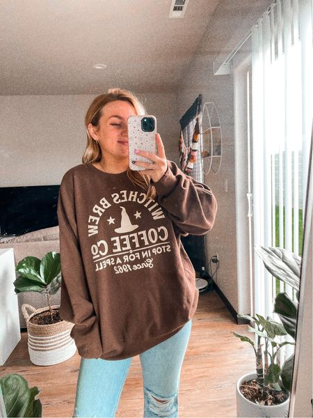 Halloween fall outfit Oversized sweatshirt Witches brew Coffee Fall styles Code SHOPSMALL for 10% off   #LTKHoliday #LTKunder50 #LTKSeasonal