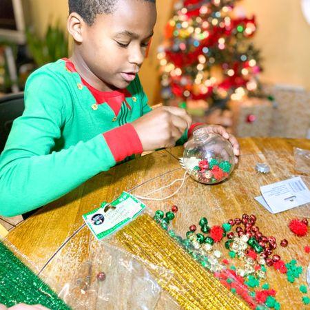 DIY Christmas ornament - clear ornament + jingle bells + pipe cleaners + google eyes in Christmas pajamas http://liketk.it/33R4X #liketkit @liketoknow.it #LTKfamily #LTKkids #LTKhome