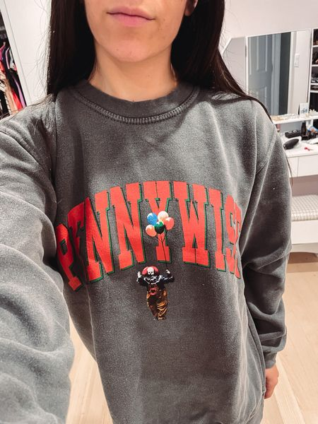Horror clothes are my jam so obviously I love this Pennywise sweatshirt! Great gift for a horror lover.   #LTKunder100 #LTKSeasonal #LTKGiftGuide