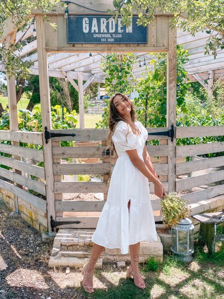 Brides: run and grab this adorable white midi dress (it's 50% off retail rn)! Love the puff sleeve and slit detail. This would be perfect for engagement photos or even a bridal shower!    #LTKunder50