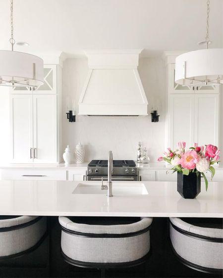 Custom white kitchen with black island decorated for Spring.  .   #LTKhome #LTKunder100 #LTKsalealert