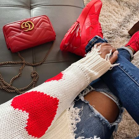 February is the month to wear a Red outfit  For Valentine's Day!!  Nike Air Max 270 Triple Red, Heart Raw Hem Sweater, Gucci Marmont Quilted Red Purse, Distressed Jeans. Screenshot this pic to get shoppable product details with the LIKEtoKNOW.it shopping app http://liketk.it/2JLi0 #liketkit @liketoknow.it
