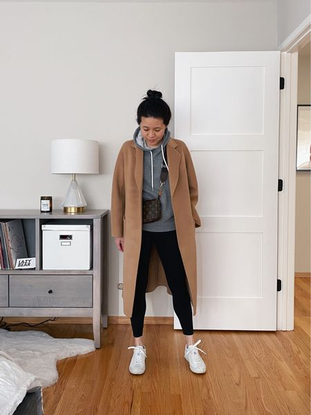 Dressing down my The Curated camel coat for an outdoor walk and errands with a cozy hoodie and comfy Rothy's sneakers.  #LTKitbag #LTKunder100