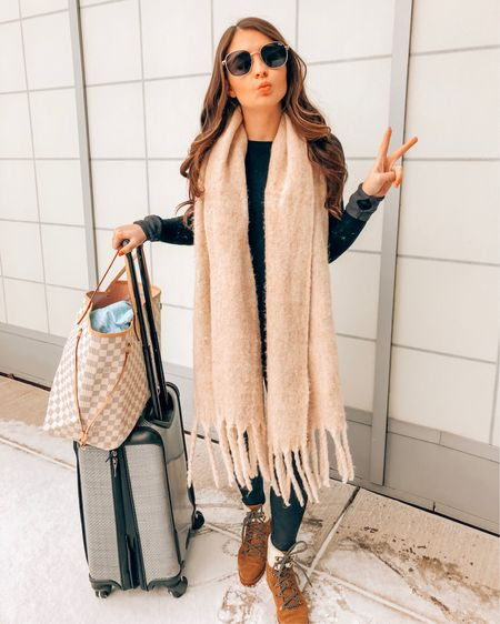 Travel ootd including spanx leggings (xs), oversized scarf, Louis Vuitton neverfull and quay sunglasses @liketoknow.it http://liketk.it/2zy3m #liketkit #LTKunder100 #LTKunder50
