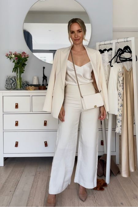 I'm 5'5 and I'm wearing a size U.K. 6 in the white Reiss blazer. Size up for a more oversized fit.  My nude Jimmy Choo heels are true to size.   My trousers are old, but I have linked some similar ones ❤️  #LTKeurope #LTKstyletip #LTKSeasonal