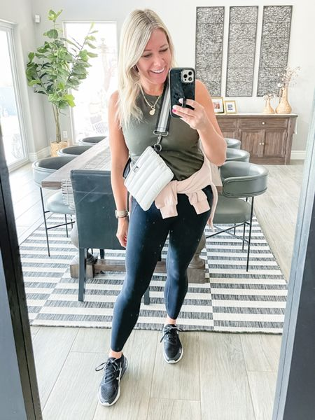 Love this white cross body convertible bum bag with this Vuori tank black leggings and Nike air max sneakers. Size small leggings, tank and sweatshirt. The Fanny pack comes in a bunch of other colors. Travel outfit Nordstrom zella leggings loft pullover   #LTKstyletip #LTKSeasonal #LTKtravel