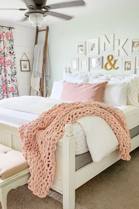 Create a cozy primary bedroom with lots of pillows, knit throw, a pretty pink sham and black out floral curtains. Other items include a blush pink sham, botanical curtains, floral sheets, blanket ladder, monogram wall decor and more simple decor. Farmhouse decorating, farmhouse design, master bedroom, primary bedroom, target finds, amazon finds, amazon home, coastal inspiration  #founditonamazon #bedroomdecorideas #homedecor #pinkbedroomdecor #ltkbedroom   #LTKSeasonal #liketkit #LTKstyletip #LTKunder50 #LTKhome @shop.ltk http://liketk.it/3km53  #LTKunder50 #LTKstyletip #LTKhome